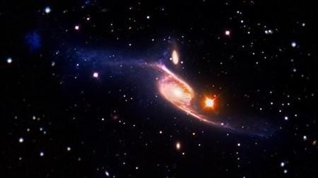 The barred spiral galaxy NGC 6872 is pictured in this undated NASA handout photo obtained by Reuters January 10, 2013. REUTERS/NASA/Handout