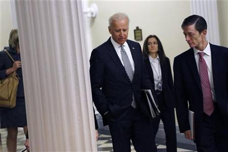 U.S. Vice President Joe Biden (C) arrives to meet with representatives from the video game industry, in a dialogue about gun violence, in his office in Washington, January 11, 2013. REUTERS/Jonathan Ernst