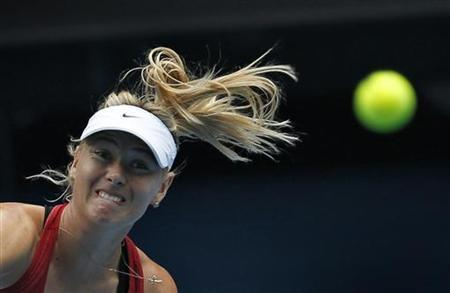 Maria Sharapova of Russia serves during a practice session at the Australian Open tennis tournament in Melbourne January 11, 2013. REUTERS/Tim Wimborne