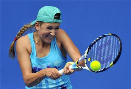 Victoria Azarenka of Belarus hits a return during a practice session at the Australian Open tennis tournament in Melbourne January 12, 2013. REUTERS/Toby Melville