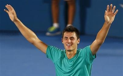 Tomic, Hewitt give locals hope, Ferrer equals record