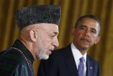 Afghan President Hamid Karzai (L) addresses a joint news conference with U.S. President Barack Obama in the East Room of the White House in Washington, January 11, 2013. REUTERS/Jason Reed (UNITED STATES - Tags: POLITICS TPX IMAGES OF THE DAY)