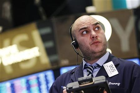 A trader works on the floor of the New York Stock Exchange, January 11, 2013. REUTERS/Brendan McDermid (UNITED STATES - Tags: BUSINESS)