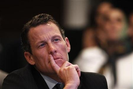 Lance Armstrong, founder of the LIVESTRONG foundation, takes part in a special session regarding cancer in the developing world during the Clinton Global Initiative in New York September 22, 2010. REUTERS/Lucas Jackson/Files