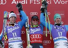 Ted Ligety of the U.S. (C) celebrates next to second-placed Fritz Dopfer of Germany (L) and third-placed Felix Neureuther of Germany on the winners podium of the Alpine Skiing World Cup men's giant slalom ski race in Adelboden January 12, 2013. REUTERS/Pascal Lauener