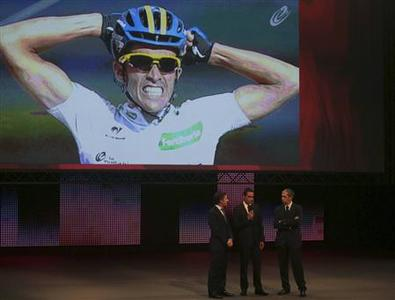 Team Saxo Bank rider and winner of the 2012 Tour of Spain, Alberto Contador (C) of Spain speaks during the 2013 Tour of Spain cycling race presentation in Garcia Barbon Theatre in Vigo, Northern Spain January 12, 2013. REUTERS/Miguel Vidal