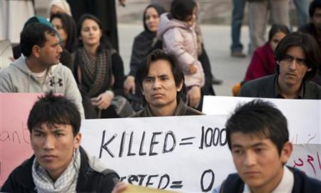 Members of the Hazara community and various non-governmental organisation (NGO) members sit-in during a protest against last Thursday's twin bomb attack in Quetta, in Islamabad January 12, 2013. REUTERS/Mian Khursheed