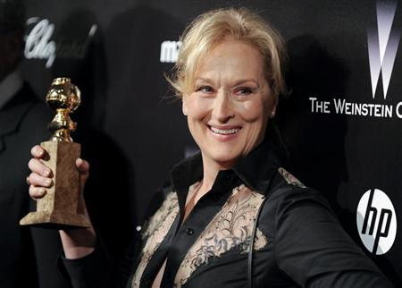 Actress Meryl Streep shows off her Golden Globe award for the best performance by an actress in a motion picture - drama for her work in '' The Iron Lady'' during her arrival at the The Weinstein Company after party following the 69th annual Golden Globe Awards in Beverly Hills, California January 15, 2012. Meryl Streep has won the most Golden Globes (eight), followed by Jack Nicholson (six) and Francis Ford Coppola, Shirley MacLaine, Rosalind Russell and Oliver Stone (five apiece). REUTERS/Gus Ruelas