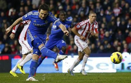 Chelsea's Frank Lampard scores a penalty against Stoke City during their English Premier League soccer match at the Britannia Stadium in Stoke-on-Trent, northern England, January 12, 2013. REUTERS/Darren Staples