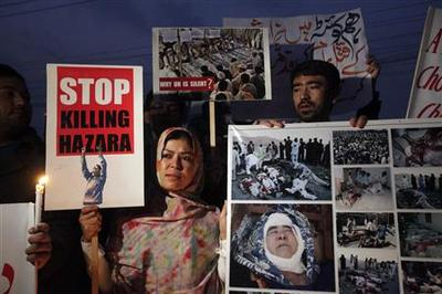 Pakistan Shi'ites watch over 96 bomb dead for second...