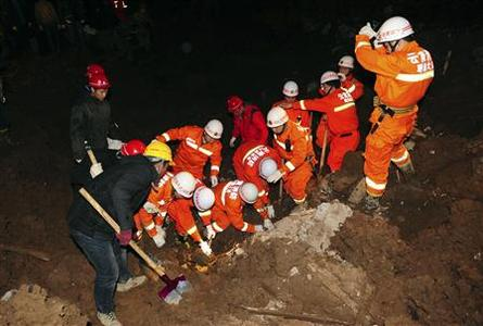 Rescuers search for buried victims after a landslide hit Zhenxiong county, Yunnan province January 11, 2013. REUTERS/China Daily