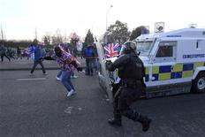 Loyalists demonstrators clash with police during rioting in East Belfast, January 12, 2013. REUTERS/Cathal McNaughton