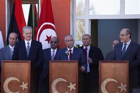 Libyan Prime Minister Ali Zeidan (C) speaks during a joint news conference with his Algerian counterpart Abdelmalek Sellal (L) and Tunisian counterpart Hamadi Jebali, in the border town of Ghadames, southwest of Tripoli January 12, 2013. REUTERS/Ismail Zitouny