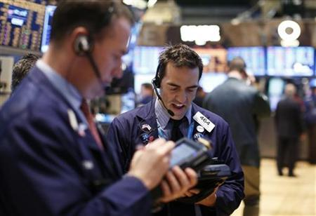 Traders work on the floor of the New York Stock Exchange, January 11, 2013. REUTERS/Brendan McDermid