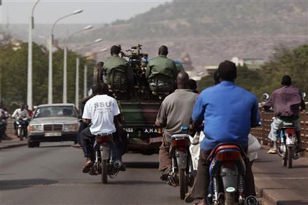 Malian soldiers drive on the streets of the capital Bamako, January 12 2013. ECOWAS will begin sending soldiers to Mali by Monday as part of a mission to drive al Qaeda-linked fighters from the country's north, an Ivory Coast government official said on Saturday. REUTERS-Joe Penney