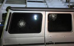 Gun shots are seen on the windows of the Italian consul's car after it was shot by unknown assailants in Benghazi January 12, 2013. An Italian consul came under fire in his car in the eastern Libyan city of Benghazi on Saturday but was unhurt, the Italian Foreign Ministry said. REUTERS/Esam Al-Fetori