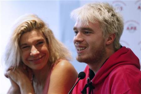 French humorist and TV host Virginie Merle (L), also known as ''Frigide Barjot'' and activist Xavier Bongibault attend a news conference in Paris, January 10, 2013. REUTERS/Charles Platiau