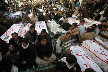 Shi'ite Muslims display the unburied coffins of victims of Thursday's twin bomb attack during a sit-in in Quetta January 12, 2013. REUTERS/Naseer Ahmed
