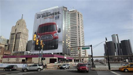 A building in downtown is covered with an auto advertisement in advance of media preview days of the North American International Auto show in Detroit, Michigan January 12, 2013. REUTERS/Rebecca Cook