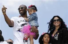 Los Angeles Lakers Kobe Bryant carries his daughter Gianna, as his wife Vanessa and daughter Natalia (2nd R) stand next to him during the NBA Championship parade in Los Angeles, California, in this June 21, 2010, file photo. REUTERS/Lucy Nicholson/Files