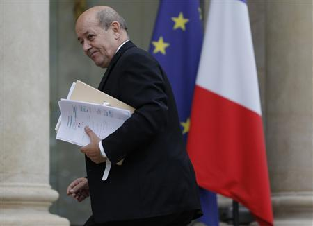 French Defence Minister Jean-Yves Le Drian arrives for a Defence Council meeting at the Elysee Palace in Paris January 12, 2013. REUTERS/Christian Hartmann