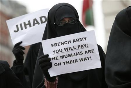 British Islamists protest outside the French Embassy in London January 12, 2013. REUTERS/Suzanne Plunkett