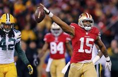 San Francisco 49ers Michael Crabtree (R) celebrate a pass reception next to Green Bay Packers Morgan Burnett (L) during the fourth quarter in their NFL NFC Divisional play-off football game in San Francisco, California January 12, 2013. REUTERS/Mike Blake
