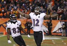Baltimore Ravens wide receiver Jacoby Jones (R) celebrates his fourth quarter touchdown against the Denver Broncos with teammate Torrey Smith in their NFL AFC Divisional playoff football game in Denver, Colorado January 12, 2013. REUTERS/Jeff Haynes