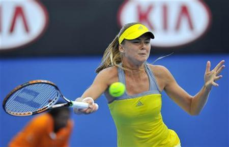 Daniela Hantuchova of Slovakia hits a return to Maria Sharapova of Russia during an exhibition match at the Australian Open tennis tournament in Melbourne January 12, 2013. REUTERS/Toby Melville