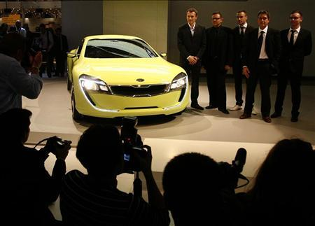Peter Schreyer (2nd L) chief design director of Kia Motors, poses wit members of his team beside a Kia concept car at the Frankfurt International Auto Show IAA in Frankfurt September 11, 2007. REUTERS/Christian Charisius