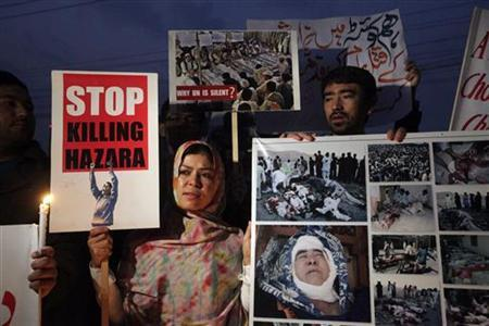 Members of the Hazara community and various non-governmental organisations (NGOs) sit-in during a protest against last Thursday's twin bomb attack in Quetta, in Lahore January 12, 2013. REUTERS/Mohsin Raza