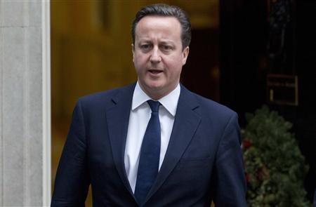 Prime Minister David Cameron leaves Downing Street in London December 19, 2012. REUTERS/Neil Hall