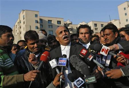V.K. Anand (C), lawyer of alleged gang leader Ram Singh, speaks with the media outside a district court in New Delhi January 10, 2013. REUTERS/Adnan Abidi