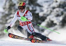Marcel Hirscher of Austria clears a gate during the first run of the Alpine Skiing World Cup men's slalom ski race in Adelboden January 13, 2013. REUTERS/Pascal Lauener