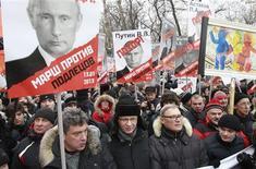 Opposition leaders (first row, L-R) Boris Nemtsov, Vladimir Ryzhkov, Mikhail Kasyanov and Ilya Yashin wait before taking part in a protest march in Moscow January 13, 2013. REUTERS/Sergei Karpukhin