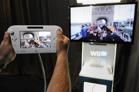 Attendees participate in a demonstration of the new Wii U GamePad and Console following the Nintendo All-Access Presentation at E3 2012, the Electronic Entertainment Expo, in Los Angeles June 5, 2012. REUTERS/Phil McCarten/Files