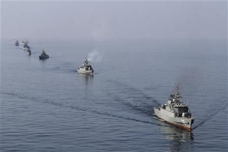 EDITORS' NOTE: Reuters and other foreign media are subject to Iranian restrictions on leaving the office to report, film or take pictures in Tehran. Iranian naval ships take part in a naval parade on the last day of the Velayat-90 war game in the Sea of Oman near the Strait of Hormuz in southern Iran January 3, 2012. REUTERS/Jamejamonline/Ebrahim Norouzi/Files
