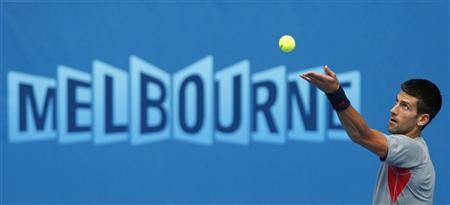 Novak Djokovic of Serbia serves during a practice session at the Australian Open tennis tournament in Melbourne January 13, 2013. REUTERS/David Gray