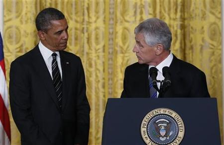 Former U.S. Senator Chuck Hagel (R) takes the podium after U.S. President Barack Obama (L) announced the nomination of Hagel to be his new Secretary of Defense, at the White House in Washington January 7, 2013. REUTERS/Kevin Lamarque