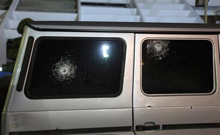 Gun shots are seen on the windows of the Italian consul's car after it was shot by unknown assailants in Benghazi January 12, 2013. REUTERS/Esam Al-Fetori