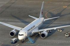 Japan Airlines' (JAL) Boeing 787 plane which leaked fuel during tests, is pictured at New Tokyo international airport in Narita, east of Tokyo, in this photo taken by Kyodo on January 13, 2013. REUTERS/Kyodo