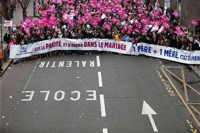 Protestors against gay marriage mass at Eiffel Tower