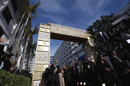 Members of the media prepare for the arrivals before the start of the 70th annual Golden Globe Awards in Beverly Hills, California, January 13, 2013. REUTERS/Mario Anzuoni