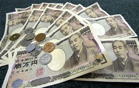 Japanese 10,000 yen bank notes and coins are displayed March 3, 2006. REUTERS/Toshiyuki Aizawa