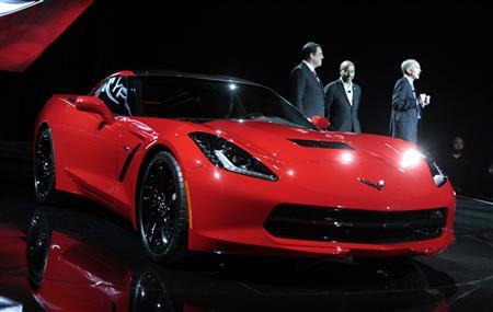 General Motors Corp. President of North America Mark Reuss (L), Vice President of Global Design Ed Welburn (C) and Executive Engineer Chevrolet Corvette Tadge Juechter talk about the Chevrolet 2014 Corvette vehicle during its unveiling in an old industrial center in advance of press preview days of the North American International Auto show in Detroit, Michigan January 13, 2013. REUTERS/Rebecca Cook