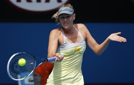 Maria Sharapova of Russia hits a return to compatriot Olga Puchkova during their women's singles match at the Australian Open tennis tournament in Melbourne, January 14, 2013. REUTERS/David Gray