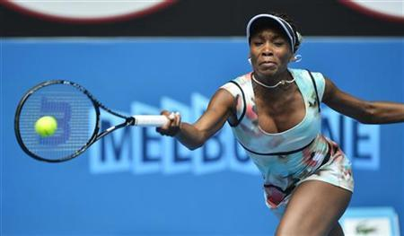 Venus Williams of the U.S. hits a return to Galina Voskoboeva of Kazakhstan during their women's singles match at the Australian Open tennis tournament in Melbourne January 14, 2013. REUTERS/Toby Melville