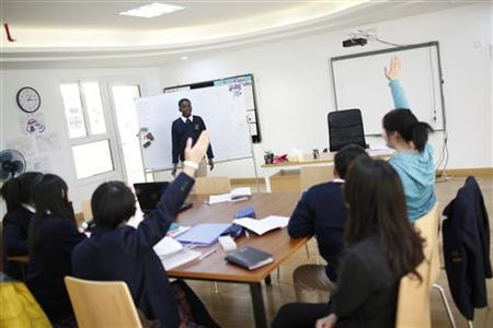 Students attend a class at the Oxford International College in Changzhou, Jiangsu province January 10, 2013. REUTERS/Aly Song