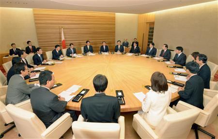 Japan's Prime Minister Shinzo Abe (rear C, yellow tie) and his cabinet ministers hold the first cabinet meeting of the year at Abe's official residence in Tokyo January 8, 2013, in this picture provided by Kyodo. Buoyed by a December election landslide, Abe is rolling out a comprehensive PR strategy mixing Facebook, public appearances and policy announcements to prop up voter ratings ahead of a crucial July poll in an effort to avoid becoming just the latest of the country's short-term leaders. Cameras were allowed to film the start of the New Year's first cabinet meeting in the room where ministers deliberate - rather than just the traditional photograph of them sitting stiffly in an ante-room. Picture taken January 8, 2013. Mandatory Credit REUTERS/Kyodo