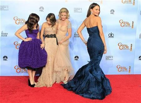 Female cast members of ''Modern Family'' (L-R) Ariel Winter, Sarah Hyland, Julie Bowen and Sofia Vergara pose backstage at the 69th annual Golden Globe Awards in Beverly Hills, California, January 15, 2012. REUTERS/Lucy Nicholson